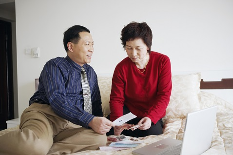 couple at home paying bills