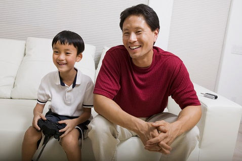 father and son playing video games