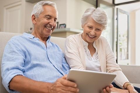 senior couple smiling tablet