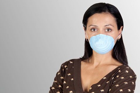 woman with allergies in mask